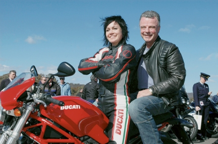 Photo courtesy LAC/W (RAAF) Kim Eager Sarah McLeod from the Ducati team with Dr Brendan Nelson. Minister for Defence Dr Brendan Nelson launched the Defence Motorcycle Awareness Campaign at the Sutton Road DriverTraining Centre, ACT near Queanbeyan on the 4th August, 2006.